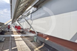 Acoustic barrier for coolers and air conditioners