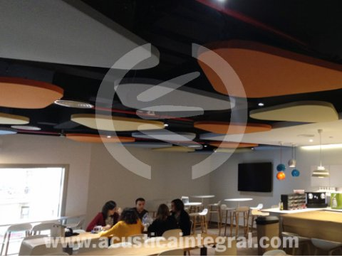 Acoustic clouds for a dining room area in offices.