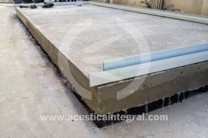 Exterior acoustic enclosure on floating slab.